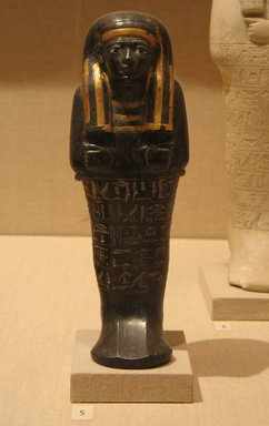 Shabti of Neferptah, ca. 1352-1279 B.C.E. Serpentine, pigment, gold, Height 8 11/16 in. (22 cm). Brooklyn Museum, Charles Edwin Wilbour Fund, 52.72. Creative Commons-BY