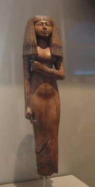 Statuette of a Woman, ca. 1390-1353 B.C.E. Wood, 10 1/16 x 2 3/4 x 1 7/8 in. (25.6 x 7 x 4.8 cm). Brooklyn Museum, Charles Edwin Wilbour Fund, 54.29. Creative Commons-BY