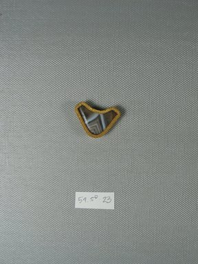 Brooklyn Museum: One of Eleven Triangular Stones