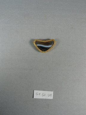 One of Eleven Triangular Stones, ca. 410 B.C.E. Gold, agate, 11/16 x 3/16 x 1 1/4 in. (1.8 x 0.5 x 3.2 cm). Brooklyn Museum, Charles Edwin Wilbour Fund, 54.50.24. Creative Commons-BY
