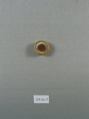 One of Fifteen Circular Stones, ca. 410 B.C.E. Gold, agate, 5/16 x Diam: 13/16 in. (0.9 x Diam: 2 cm). Brooklyn Museum, Charles Edwin Wilbour Fund, 54.50.9. Creative Commons-BY