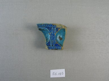 Fragment of Inkwell?, 664-30 B.C.E. Faience, glazed, 1 x 1 7/16 x 1 13/16 in. (2.5 x 3.7 x 4.6 cm). Brooklyn Museum, Gift of Michel Abemayor, 55.185. Creative Commons-BY