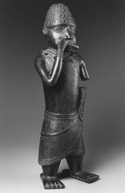 Edo. Figure of a Hornblower, ca. 1504-50. Copper alloy, 24 1/2 x 8 1/2 x 6 in. (62.2 x 21.6 x 15.2 cm). Brooklyn Museum, Gift of Mr. and Mrs. Alastair B. Martin, the Guennol Collection, 55.87. Creative Commons-BY