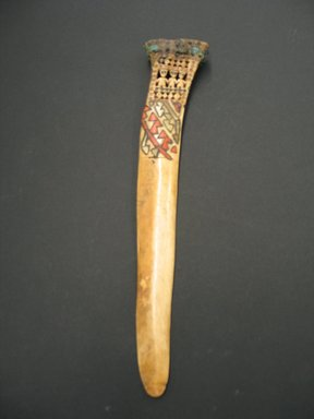 Ica. Ceremonial Weaving Knife, 1300-1400. Bone, shell, feathers, 2 3/8 x 11 1/4 in. (6.1 x 28.6 cm). Brooklyn Museum, By exchange, 56.190.2. Creative Commons-BY
