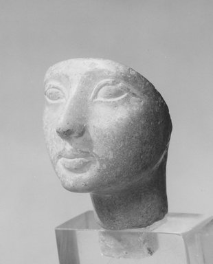 Head of Woman. Glass, 2 1/2 x 1 9/16 x 2 13/16 in. (6.4 x 4 x 7.1 cm). Brooklyn Museum, Charles Edwin Wilbour Fund, 57.164. Creative Commons-BY