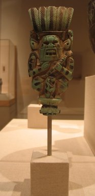 Plaque of Bes figure, ca. 945-718 B.C.E. Faience, glazed, 5 15/16 x 2 1/2 x 15/16 in. (15.1 x 6.4 x 2.4 cm). Brooklyn Museum, Charles Edwin Wilbour Fund, 58.171. Creative Commons-BY