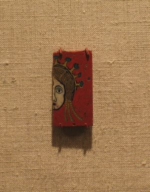 Plaque with Half of a Female Head, 100 B.C.E.-100 C.E. Fused mosaic glass, 1 1/8 x 5/8 in. (2.9 x 1.6 cm). Brooklyn Museum, Charles Edwin Wilbour Fund, 58.93.3. Creative Commons-BY