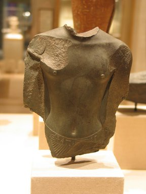 Torso from a Standing Statuette of a King, ca. 664-570 B.C.E. Schist, 6 1/16 x 4 13/16 x 1 9/16 in. (15.4 x 12.2 x 4 cm). Brooklyn Museum, Charles Edwin Wilbour Fund, 58.95. Creative Commons-BY