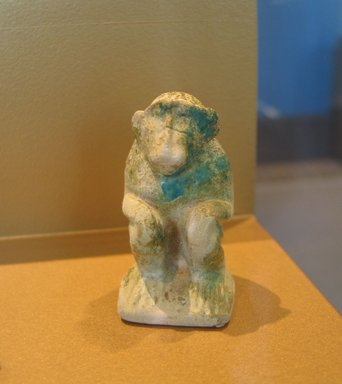 Statuette of Seated Cynocephalus Ape, ca. 1938-1700 B.C.E. Faience, 2 1/2 x 1 1/2 x 1 3/4 in. (6.4 x 3.8 x 4.4 cm). Brooklyn Museum, Charles Edwin Wilbour Fund, 59.199.3. Creative Commons-BY