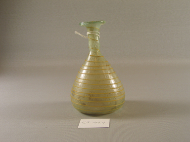 Vase, 4th century C.E. Blown glass, 4 x Diam. 2 9/16 in. (10.2 x 6.5 cm). Brooklyn Museum, Charles Edwin Wilbour Fund, 59.199.4. Creative Commons-BY