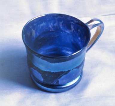 Tiffany Studios (1902-1932). Mug, ca. 1900. Opalescent glass, 3 1/8 x 5 x 3 5/8 in. (7.9 x 12.7 x 9.2 cm). Brooklyn Museum, Gift of Alfred M. F. Kiddle, 62.102.5. Creative Commons-BY