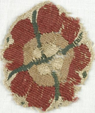 Coptic. Tapestry Roundel, 5th-7th century C.E. Flax, Wool, 3 1/4 x 4 1/4 in. (8.3 x 10.8 cm). Brooklyn Museum, Gift of Adelaide Goan, 64.114.245