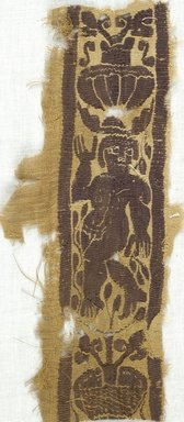 Coptic. Fragment with Tapestry Inset, 5th-7th century C.E. Flax, Wool, 4 1/4 x 8 1/2 in. (10.8 x 21.6 cm). Brooklyn Museum, Gift of Adelaide Goan, 64.114.256