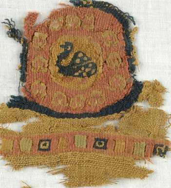 Coptic. Fragment with Tapestry Roundel with Bird in Center, 5th-7th century C.E. Wool, 3 1/4 x 3 1/4 in. (8.3 x 8.3 cm). Brooklyn Museum, Gift of Adelaide Goan, 64.114.258