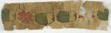 Coptic. Fragment with Tapestry Strip of Flowers and Ovals, 5th-7th century C.E. Flax, Wool, 1 3/4 x 6 1/4 in. (4.4 x 15.9 cm). Brooklyn Museum, Gift of Adelaide Goan, 64.114.262