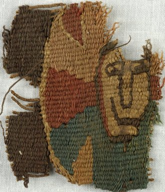 Coptic. Tapestry Fragment with Face, 5th-7th century C.E. Flax, Wool, 1 15/16 x 1 15/16 in. (5 x 5 cm). Brooklyn Museum, Gift of Adelaide Goan, 64.114.264