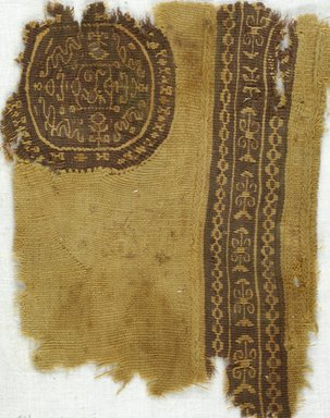 Coptic. Fragment with Round and Strip Tapestry Insets, 5th-7th century C.E. Wool, 6 1/4 x 7 3/4 in. (15.9 x 19.7 cm). Brooklyn Museum, Gift of Adelaide Goan, 64.114.268