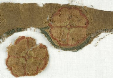 Coptic. Fragment of Tapestry with Three Flower Roundels, 5th-7th century C.E. Wool, linen, 4 1/2 x 11 1/4 in. (11.4 x 28.6 cm). Brooklyn Museum, Gift of Adelaide Goan, 64.114.269