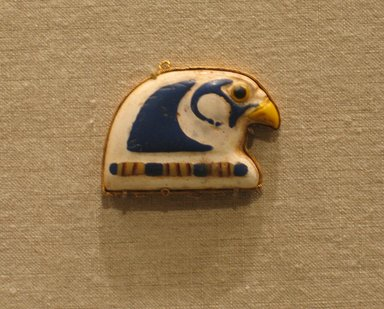 Pendant, 305-30 B.C.E. Gold, glass, 1 3/8 x 1 3/4 x 1/4 in. (3.5 x 4.5 x 0.7 cm). Brooklyn Museum, Charles Edwin Wilbour Fund, 65.3.2. Creative Commons-BY