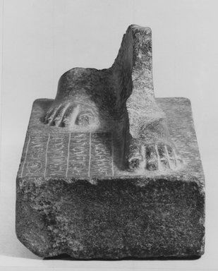 Statue Base. Granite, 6 1/2 x 3 3/4 in. (16.5 x 9.6 cm). Brooklyn Museum, Charles Edwin Wilbour Fund, 65.47. Creative Commons-BY