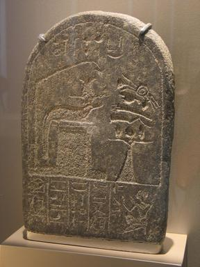 Round-Topped Stela Amenemhat, ca. 1479-1425 B.C.E. Granite, 13 3/4 x 9 7/16 x 3 9/16 in. (34.9 x 24 x 9 cm). Brooklyn Museum, Charles Edwin Wilbour Fund, 66.174.2. Creative Commons-BY