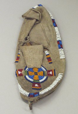 Blackfoot (Native American). Child's Moccasin with Beaded Cross and Circle Design, 1930s. Beads, sinew, cotton thread, 8 7/8 x 3 3/4 in. (22.5 x 9.5 cm). Brooklyn Museum, Gift of Mr. and Mrs. Jerome Blum, 66.86.25. Creative Commons-BY