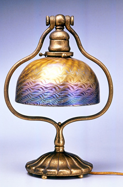Tiffany Studios (1902-1932). Lamp, ca. 1910. Glass, matted bronze, 13 1/8 x 9 3/8 x 7 1/8 in. (33.3 x 23.8 x 18.1 cm). Brooklyn Museum, Bequest of Laura L. Barnes, 67.120.56. Creative Commons-BY