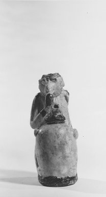 Ape Holding a Vessel, 7th-6th century B.C.E. Faience, 3 11/16 x 1 9/16 x 2 5/16 in. (9.3 x 4 x 5.8 cm). Brooklyn Museum, Charles Edwin Wilbour Fund, 67.1. Creative Commons-BY