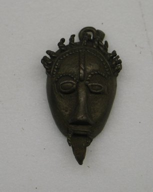 Akan. Mask., 1 5/8 x 1 x 3/8 in. (4.2 x 2.5 x 1 cm). Brooklyn Museum, Bequest of Laura L. Barnes, 67.25.5. Creative Commons-BY