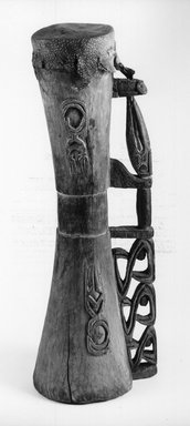 Asmat. Hourglass Shaped Drum. Carved wood, lizard skin head, 3 3/4 x 2 7/8 x 10 1/4 in. (9.5 x 7.3 x 26 cm). Brooklyn Museum, Gift of Mr. and Mrs. Stanley Ross, 68.220.1. Creative Commons-BY