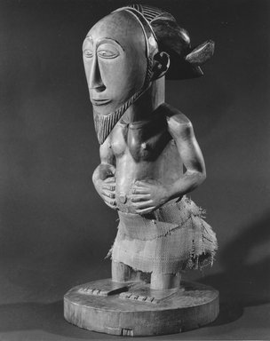 Hemba. Standing Male Figure (Sigiti), late 19th century. Carved, stained lightwood, incised, polished, woven reed, 17 3/4 x 8 x 8 in. (45.1 x 20.3 x 20.3 cm). Brooklyn Museum, Gift of the Florence and Carl L. Selden Foundation, 68.32. Creative Commons-BY