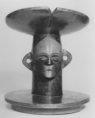 Mangbetu. Lid with Figurative Head, 19th century. Wood, stain, 11 x 9 x 9 in. (27.9 x 22.9 x 22.9 cm). Brooklyn Museum, Ella C. Woodward Memorial Fund, 68.33. Creative Commons-BY