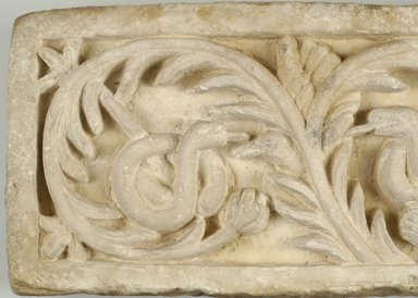 Recarved Plant Scroll with Snakes and Bird Heads, Ancient, recut in the 20th Century C.E. Limestone, 10 1/16 x 20 1/16 x 4 1/4 in. (25.5 x 51 x 10.8 cm). Brooklyn Museum, Charles Edwin Wilbour Fund, 68.3. Creative Commons-BY