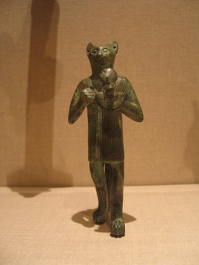 Statuette of Re as a Standing Tomcat, 305-30 B.C.E. Bronze, 5 7/8 x 2 1/4 in. (14.9 x 5.7 cm). Brooklyn Museum, Charles Edwin Wilbour Fund, 69.113. Creative Commons-BY