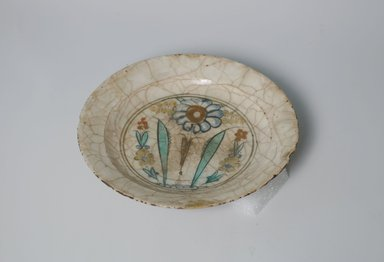Plate, early 17th century. Ceramic, Kubachi ware; fritware, painted in black, blue and turquoise green with red and yellow slips under a transparent glaze, 1 5/8 x 7 9/16 in. (4.2 x 19.2 cm). Brooklyn Museum, Gift of Mrs. James Leipner, 69.120.1. Creative Commons-BY