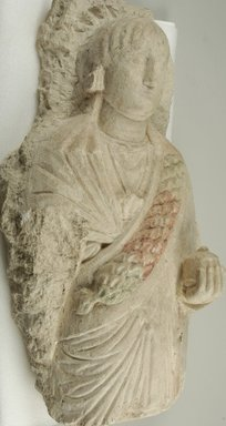 Funerary Figure of a Woman, 3rd - 4th century C.E. Limestone, traces of gesso and paint, 34 5/8 x 20 1/16 x 11 13/16 in. (88 x 51 x 30 cm). Brooklyn Museum, Charles Edwin Wilbour Fund, 70.132. Creative Commons-BY