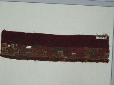 Coastal Wari (attrib by Nobuko Kajatani, 1993). Mantle, Fragment, 600-1000 C.E. Cotton, camelid fiber, 3 15/16 x 14 15/16 in. (10 x 38 cm). Brooklyn Museum, Gift of Ernest Erickson, 70.177.54. Creative Commons-BY
