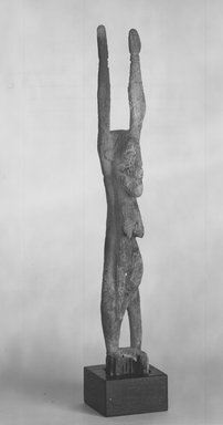 Dogon. Female Figure of a Nommo, 15th - 17th century?. Wood, accumulated materials, 14 3/4 x 2 1/2 x 2 in. (37.5 x 6.5 x 5.1 cm). Brooklyn Museum, Gift of Lester Wunderman, 70.178.3. Creative Commons-BY