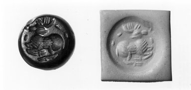 Ancient Near Eastern. Stamp Seal: Recumbent Stag, 5th century C.E. Jasper, 3/8 x 1/2 in. (1 x 1.2 cm). Brooklyn Museum, Twentieth-Century Fox Fund, 71.115.15. Creative Commons-BY