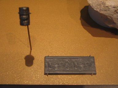 Ancient Near Eastern. Western Asiatic Cylinder Seal with Running Spiral, ca. 1450-1400 B.C.E. Hematite, 5/8 x Diam. 3/8 in. (1.6 x 1 cm). Brooklyn Museum, Twentieth-Century Fox Fund, 71.115.6. Creative Commons-BY