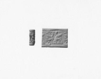 Ancient Near Eastern. Cylinder Seal, 8th century B.C.E. Stone, glazed, 1 1/16 x Diam. 3/8 in. (2.7 x 1 cm). Brooklyn Museum, Twentieth-Century Fox Fund, 71.115.8. Creative Commons-BY
