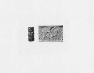 Ancient Near Eastern. Cylinder Seal, 7th century B.C.E. Serpentine, 1 1/8 x Diam. 1/2 in. (2.8 x 1.2 cm). Brooklyn Museum, Twentieth-Century Fox Fund, 71.115.9. Creative Commons-BY