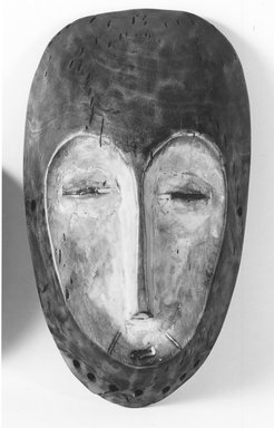 Lega. Mask (Lukwakongo), 19th or 20th century. Wood, kaolin clay, 10 1/2 x 6 x 2 1/4 in. (26.7 x 15.2 x 5.7 cm). Brooklyn Museum, Gift of Nicholas A. de Kun, 71.173. Creative Commons-BY