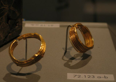 Earrings, Pair of Corrugated Hoops, ca. 1539-1292 B.C.E. Gold, 72.123a: 1 5/8 x 1/2 x 1 7/16 in. (4.1 x 1.3 x 3.7 cm). Brooklyn Museum, Charles Edwin Wilbour Fund, 72.123a-b. Creative Commons-BY