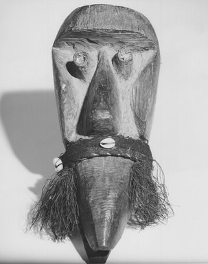 Possibly Dan. Mask, late 19th or early 20th century. Wood, fiber, shell, 12 x 6 x 4 3/4 in. (30.5 x 15.2 x 12.1 cm). Brooklyn Museum, Gift of Dr. and Mrs. Abbott A. Lippman to the Jennie Simpson Educational Collection of African Art, 72.172.1. Creative Commons-BY