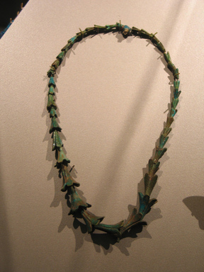 Necklace with Beads in Form of Jasmine Blossoms, ca. 1319-1190 B.C.E. Faience, Length: 20 7/8 in. (53 cm). Brooklyn Museum, Gift of Helena Simkhovitch in memory of her father, Vladimir G. Simkhovitch, 72.56. Creative Commons-BY