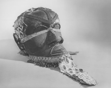 Kuba (Bushoong subgroup). Bwoom Mask, late 19th or early 20th century. Wood, cowrie shells, glass beads, fur, leather, cloth, seed pods, 13 3/4 x 8 1/4 x 12 in. (35 x 21 x 30.5 cm). Brooklyn Museum, Gift of the Anne Eisner Putnam Collection, 73.178. Creative Commons-BY