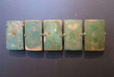 Tile from a Royal Funerary Structure, ca. 2675-2625 B.C.E. Faience, 2 3/16 x 1 7/16 x 11/16 in. (5.6 x 3.6 x 1.8 cm). Brooklyn Museum, Charles Edwin Wilbour Fund, 73.84.1. Creative Commons-BY