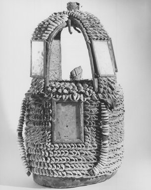 Yoruba. House of the Head, early 20th century. Cowrie shells, wood, leather, fiber, mirrors, 16in. (40.6cm). Brooklyn Museum, Gift of Mr. and Mrs. Joseph Gerofsky, 73.9.3. Creative Commons-BY
