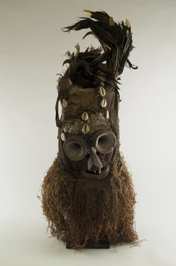 Luntu. Fiber Mask with Conical Eyes (Batwape), late 19th or early 20th century. Burlap, wood, hide, cotton fiber, feathers, seeds, cowrie shells, pigment, 28 1/2 x 11 x 12 in. (72.4 x 28.0 x 30.5 cm). Brooklyn Museum, Gift of Marcia and John Friede, 74.121.3. Creative Commons-BY